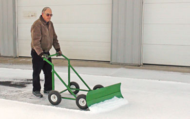 "Paul Starner demonstrates an eco-friendly, easy-to-use snow plow that he and his neighbor, Jerry Schichtel, developed and call the ""Snow Bully."" Their website is TheSnowBully.com."