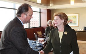 Craig Borr, MECA President/CEO, greets U.S. Sen. Debbie Stabenow at an electric co-op meeting in Lansing. MECA and its electric co-op members work to build a close working relationship with elected officials on behalf of the co-ops' consumer members.