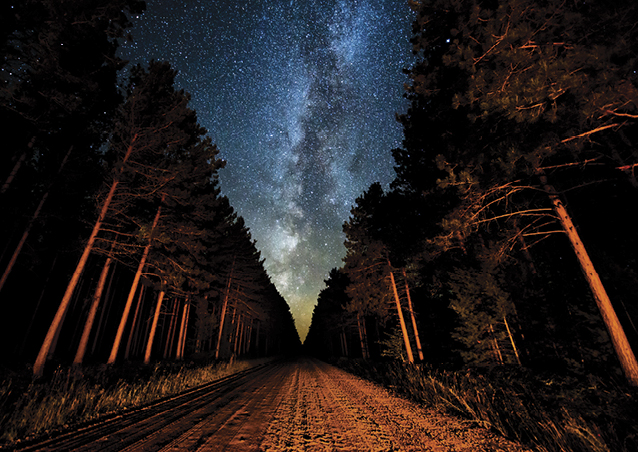 Milky Way Road—A unique shot of the milky way on a moonless night, creatively lit by the car's headlights.