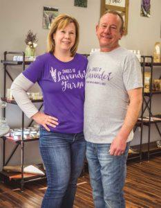 Janene & Scott Rawlinson standing in their lavender shop