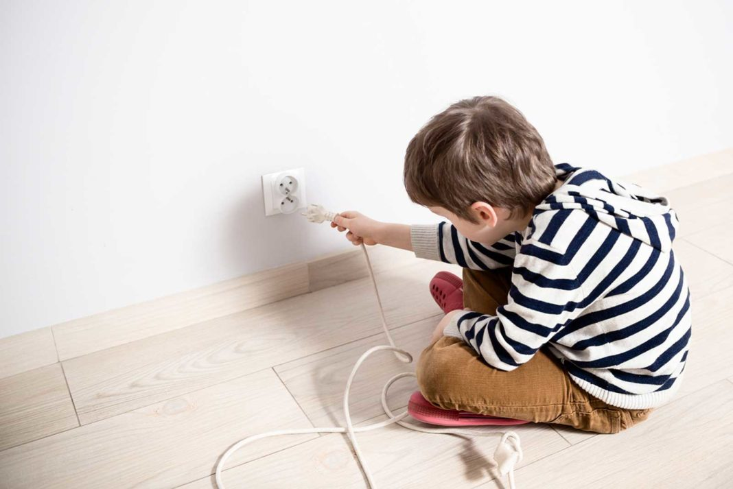 Kid plugging in power cord